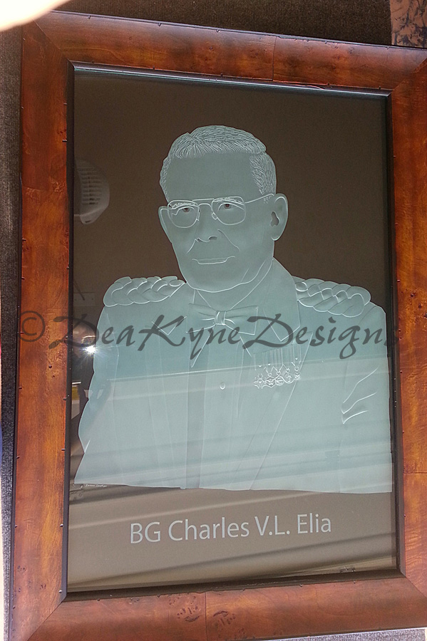 Portrait carved sculpted into laminated glass